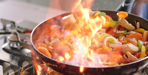 Flambing Chicken and Vegetables
