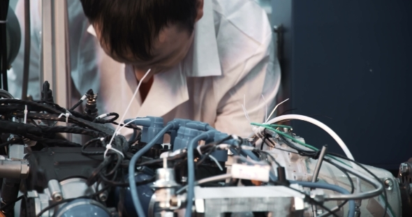 A Technician Performing Periodic Engine