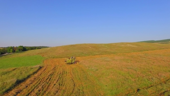 AERIAL VIEW. Working Harvesting Combine In The