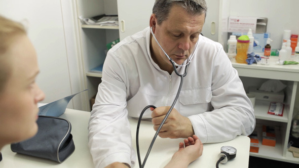 Doctor Measures The Blood Pressure