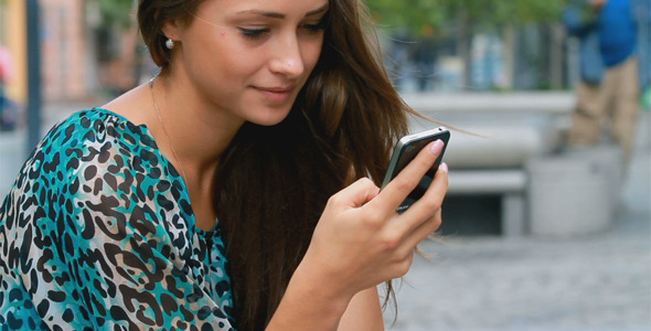 Girl Typing On A Mobile Phone