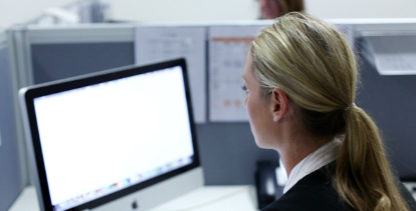 Girl Working in Office at Computer Typing