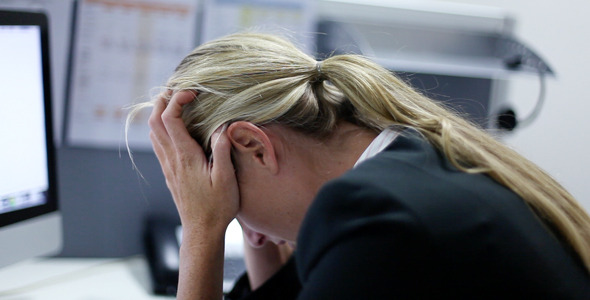 Girl Working in Office at Computer Very Stressed