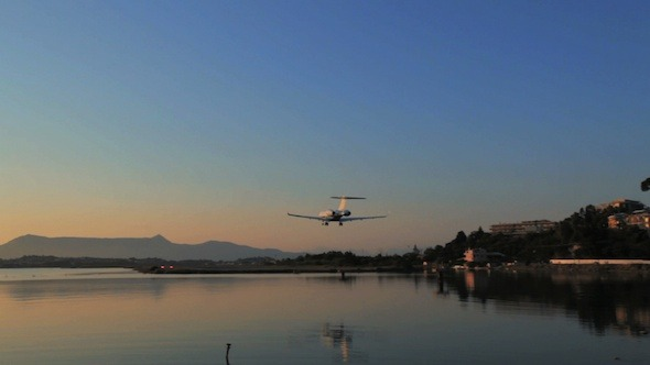 Two Airplanes Landing, Sunset Scenes in Airport