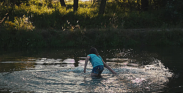 Beautiful Girl is Playing in the River