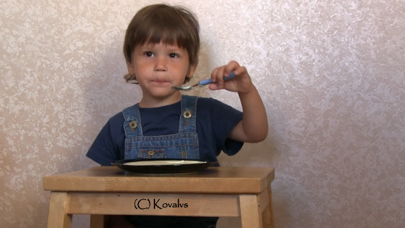 Boy Eating Porridge