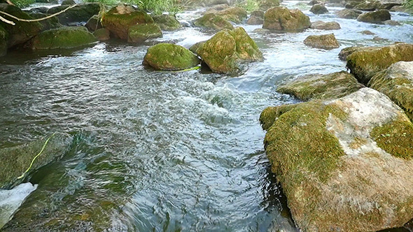 Fast Flowing River With Stones In Water