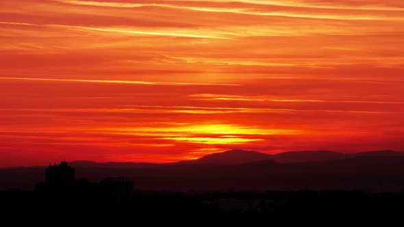 Fiery Sunset Sky Above Hills