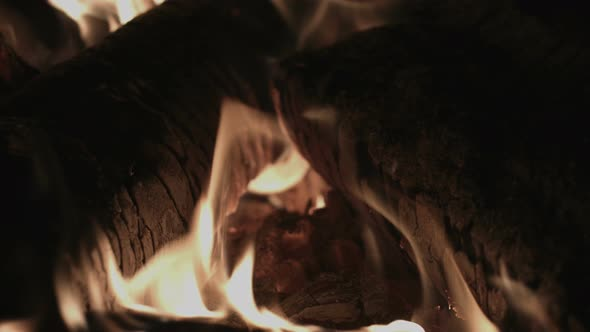 Fireplace Fire And Logs In A Stove