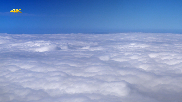 Flying Over Clouds from Airplane Window