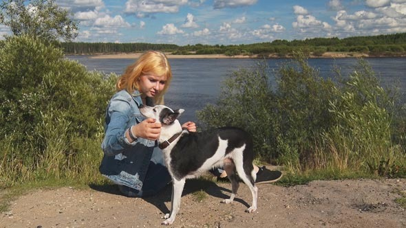 Girl With a Dog and a Telephone Near the River