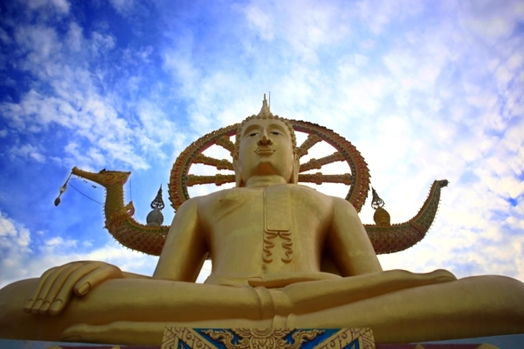 Golden Buddha Statue Against Blue Sky With Moving