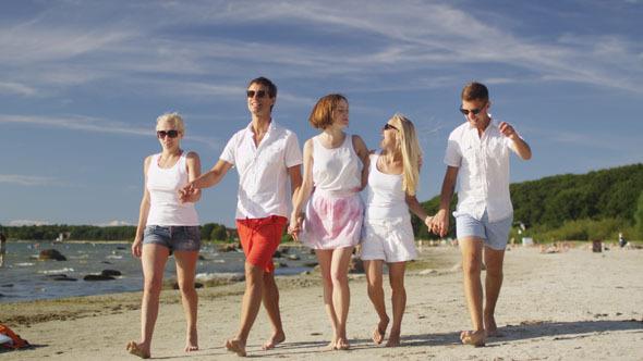 Group of Friends are Walking on Beach