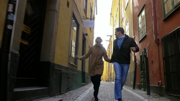 Happy Run Together In Old City Street