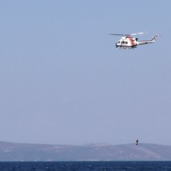 Helicopter is Holding Diver and Sea