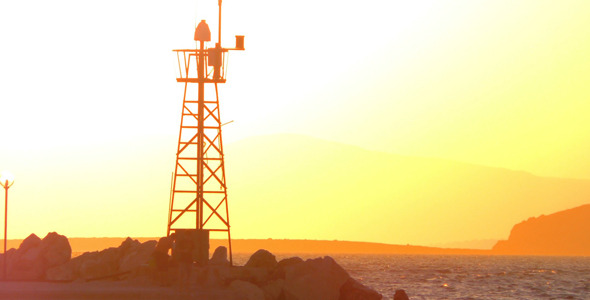 Lighthouse and the People Silhouette in Sunset