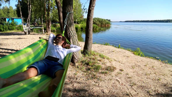 Man Relaxing in a Hammock