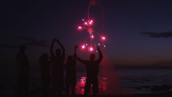 People are Staying on Beach and Watching Fireworks