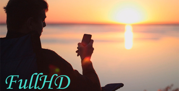The Man With Phone At Sunrise